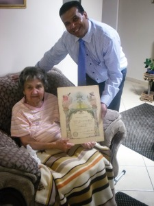 Sister Evelyn Hodgkiss displaying her confirmation certificate dated 1937.